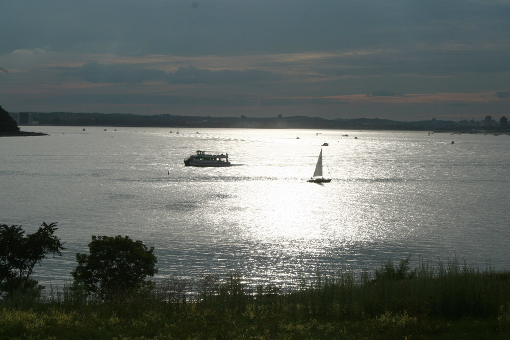 Boston Harbor, View from Spectacle Island, with boats and shine of sun, sunshine on the water
