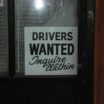 Sign by taxi office : Drivers wanted, Inquire within