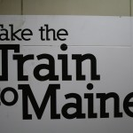 Boston Graphic Design, Amstrak Downeaster sign logo cover train station, Take the Train to Maine